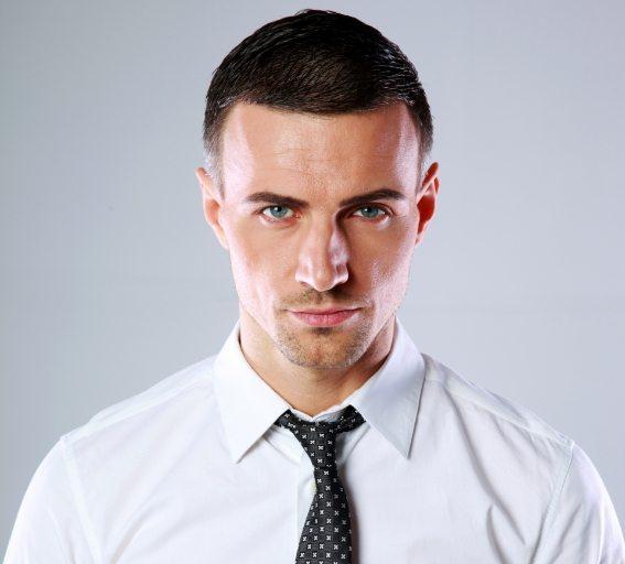 portrait-of-a-confident-man-over-gray-background-PDL3Q9F