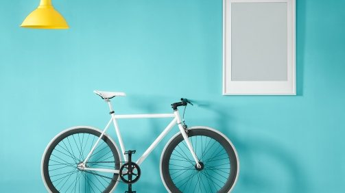 white-bike-in-blue-interior-PMNFYVU