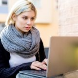 young-focused-woman-working-on-laptop-at-outdoor-PTTFVNE