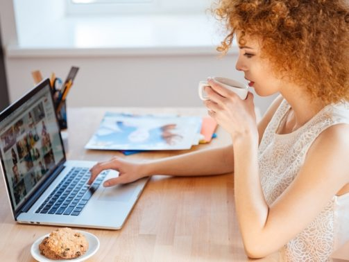 woman-photographer-drinking-coffee-and-working-PJNBP6U@2x