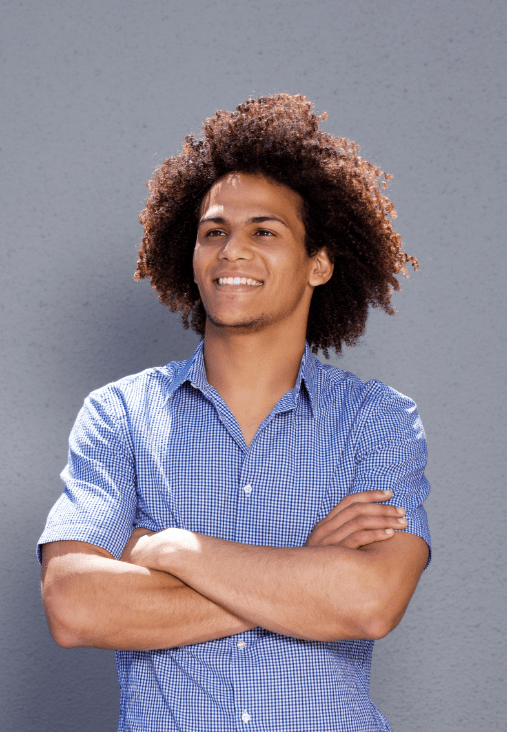 smiling-confident-man-standing-with-arms-crossed-DMBEGAW