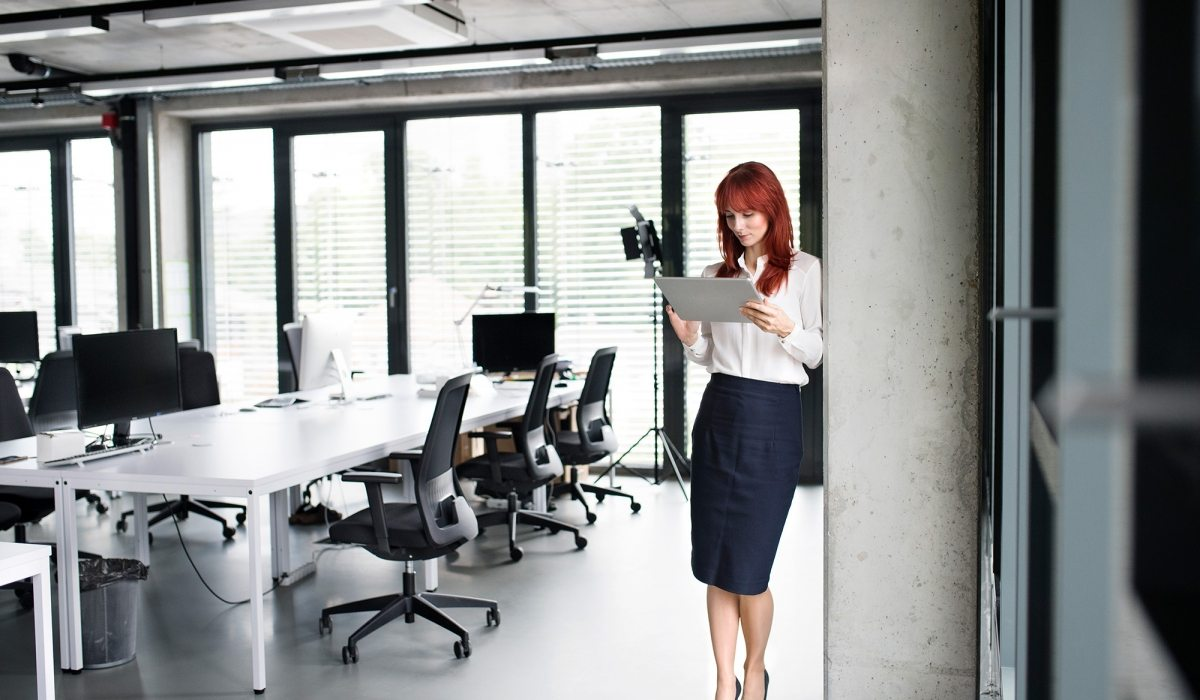 Businesswoman-with-tablet-in-her-office-working.