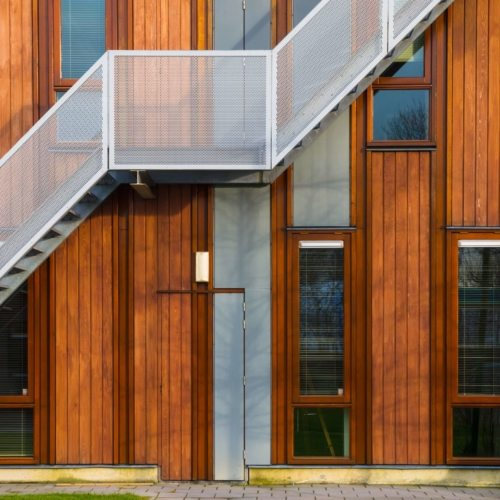 Escape stairs on a modern sustainable wooden office facade