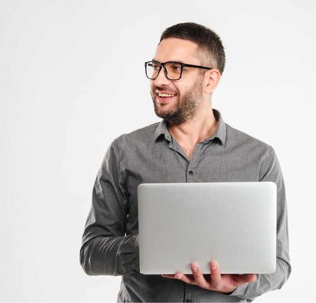 concentrated-businessman-using-laptop-computer-PE3ARHB