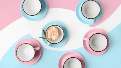 elegant-porcelain-blue-and-pink-cups-on-abstract-PRAGU4T