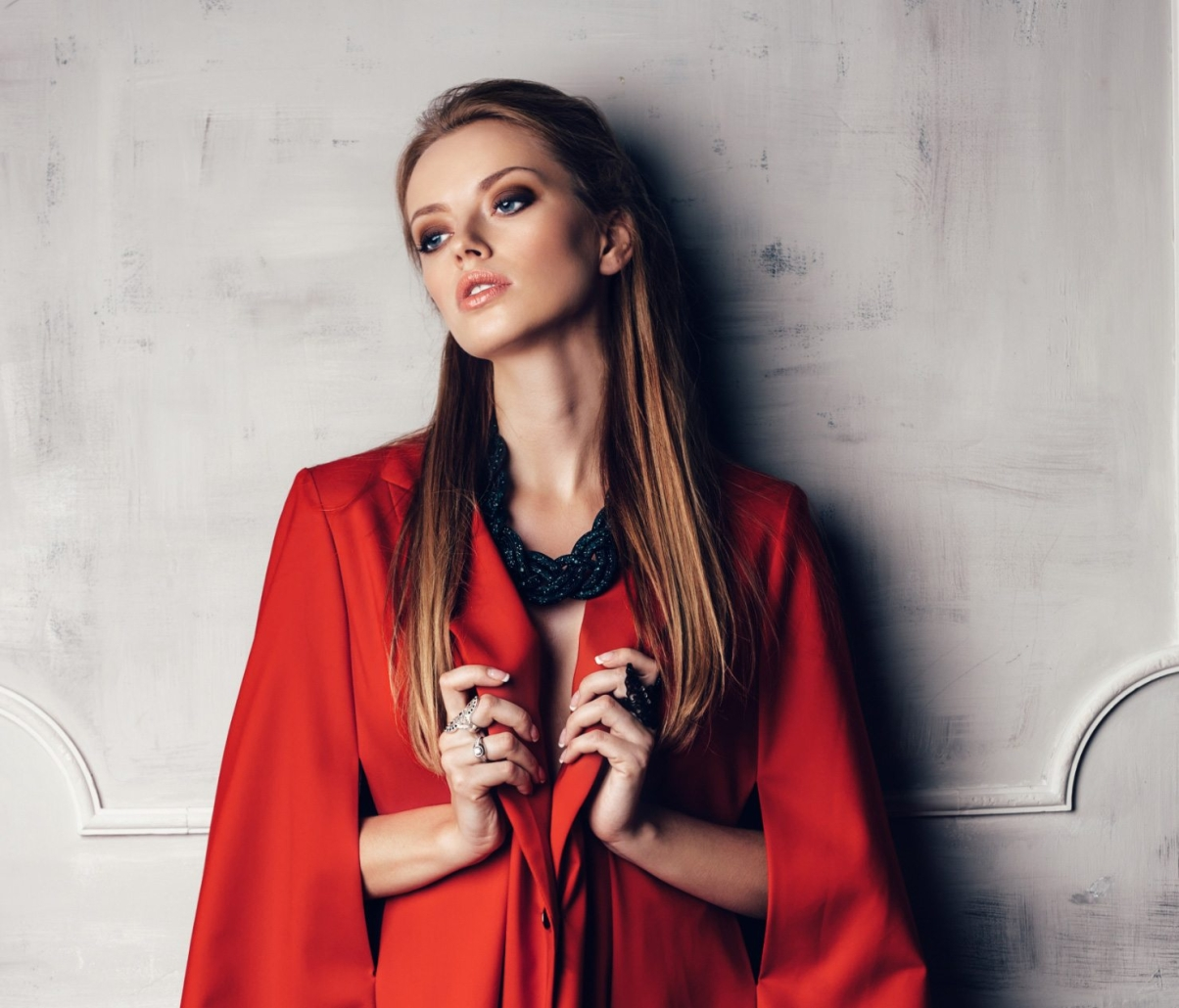 fashion-young-beautiful-woman-in-red-coat-PKM7M7Z