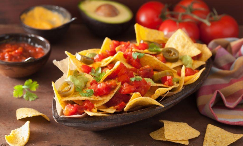 nachos-loaded-with-salsa-guacamole-cheese-and-P7GUFN7