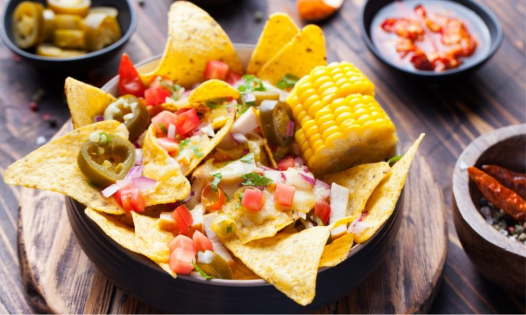 nachos-with-melted-cheese-sauce-salsa-corn-cobs-PMBWCHA