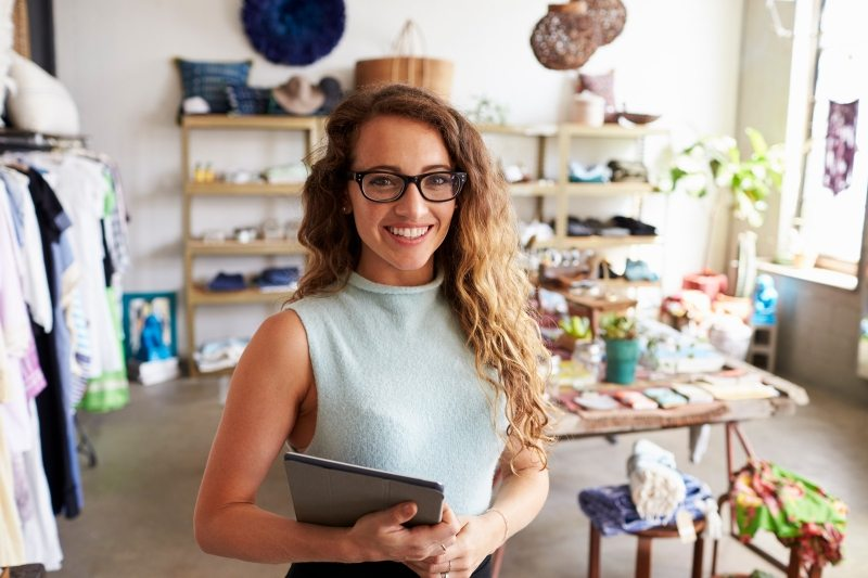 female-business-owner-holding-tablet-computer-in-PEVERD4