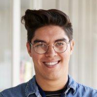 portrait-of-smiling-male-school-teacher-standing-7BJLS3R