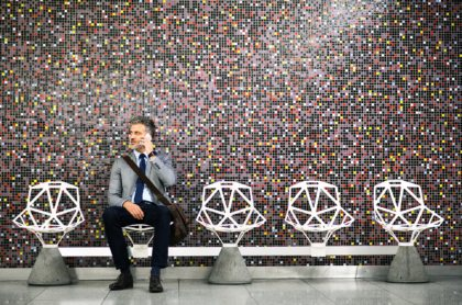 Mature-businessman-with-smartphone-in-a-metro-station.