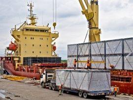 loading-cargo-into-the-ship-in-harbor-PF86726