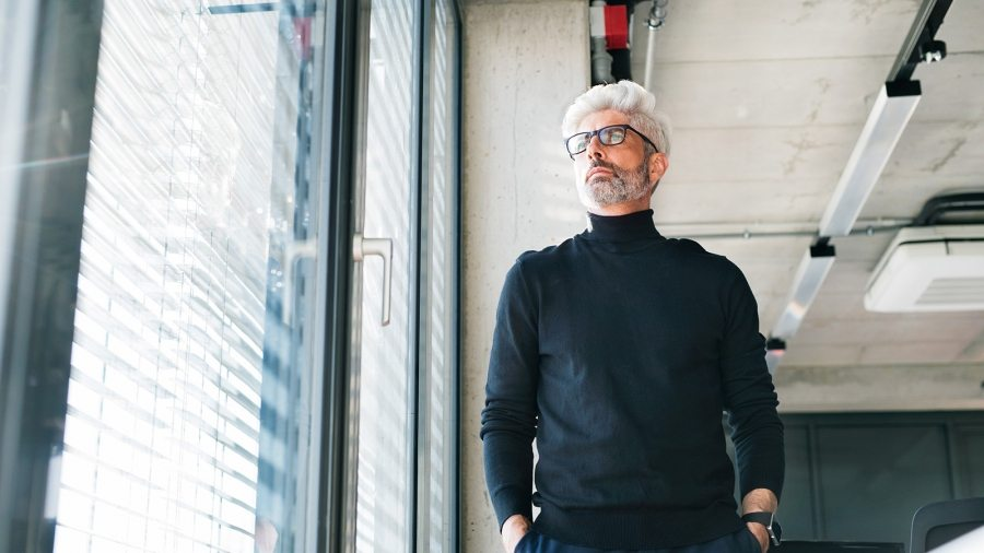 mature-businessman-with-gray-hair-in-the-office-PF9SFHW