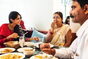 family-having-indian-food-PU9L7XJ