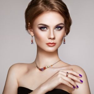 portrait-beautiful-woman-with-jewelry-8Q75FCK