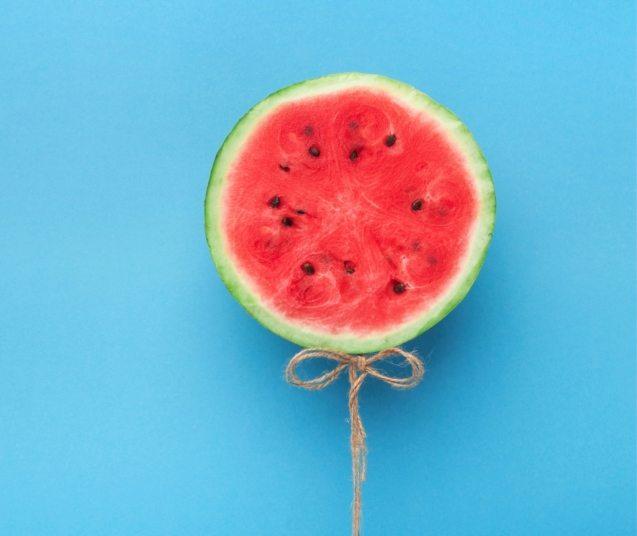watermelon-balloon-on-blue-background-creative-57PNH8Q