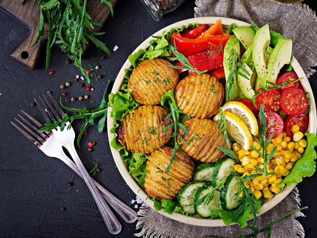 vegetarian-buddha-bowl-raw-vegetables-and-baked-KAYZM53