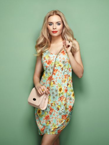 young-woman-in-floral-summer-dress-PRDWLEH