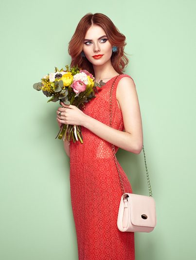 blonde-young-woman-in-elegant-red-dress-P37BD78