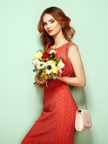 young-woman-in-elegant-red-dress-P8T7ZJQ