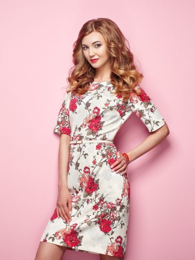 young-woman-in-floral-spring-summer-dress-PKLEF4Q