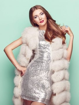 fashion-portrait-young-woman-in-white-fur-coat-PVH6FGS
