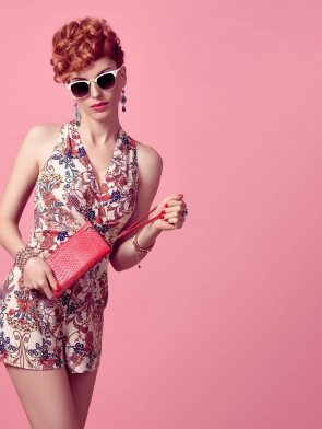 fashion-redhead-model-in-summer-jumpsuit-on-pink-PXX3EL8