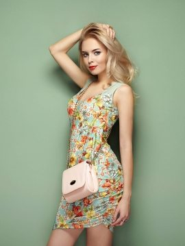 woman-in-floral-summer-dress-PXNJUKP