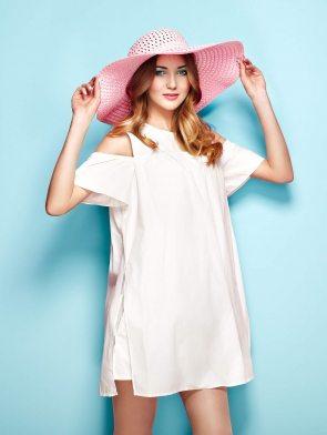 woman-in-summer-white-dress-P8TTMFV