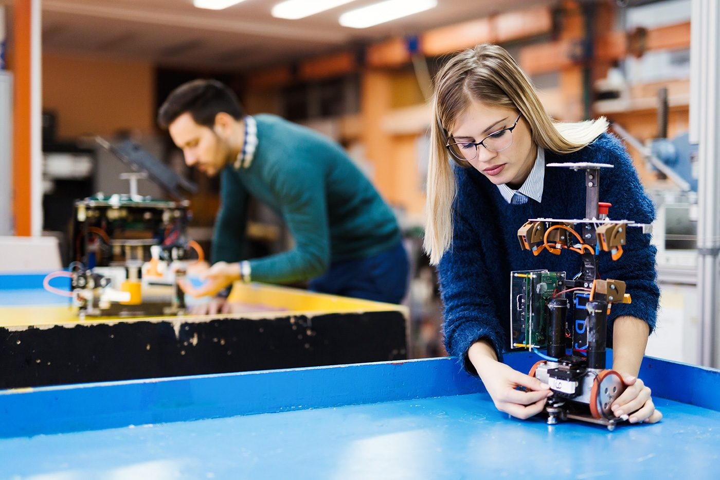 young-student-of-robotics-working-on-project-S32GWUC