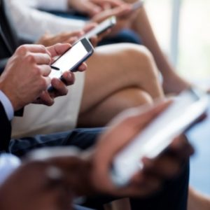 close-up-of-business-executives-using-mobile-8TJSZAP@2x