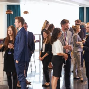 delegates-networking-at-conference-drinks-PJX2DZ7@2x